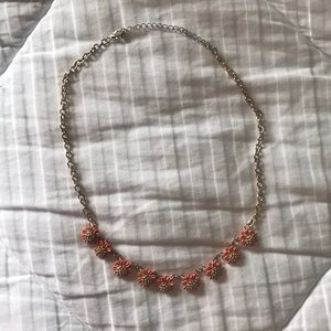 Necklace with gold chain and orange flowers